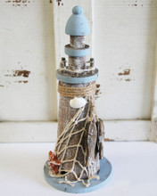 Coastal Lighthouse with Starfish, Net & More
