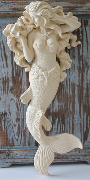 "Current ""tan"" colored mermaid"