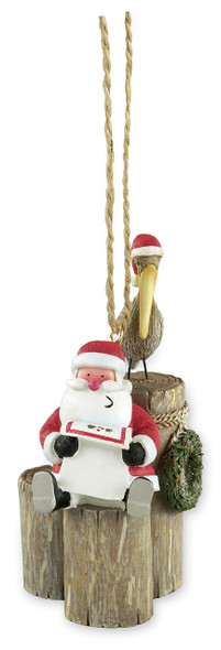 Santa with Pelicans on Pilings