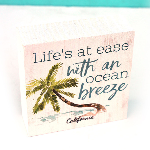 Life's at ease with an ocean breeze sign.