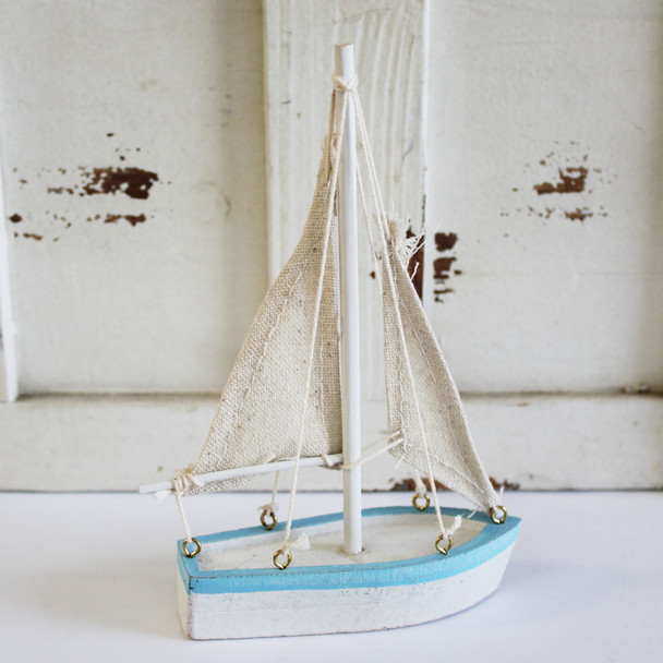 White & Light Blue Sail Boat