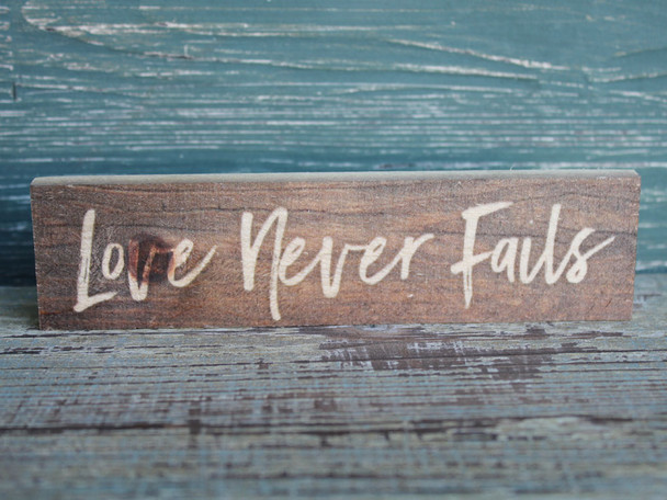 Love Never Fails small wood sign