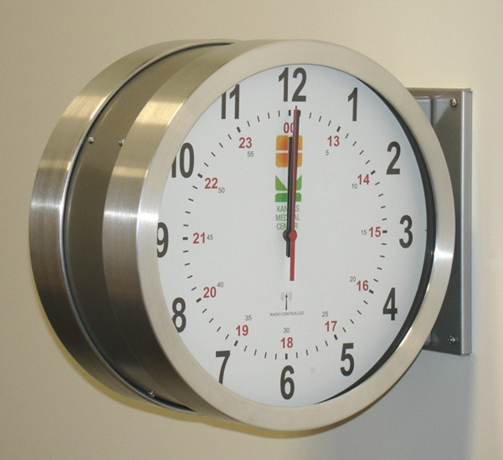 "DuraTime 12"" Double Sided Brushed Aluminum Analog Clock, Battery Operated. Available in 12"" and 15"" diameter. Contact us for advice and prices."