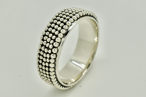 Silver halo bangle with oxidase design on top with little balls. Quality .925 silver from Taxco Mexico handcrafted