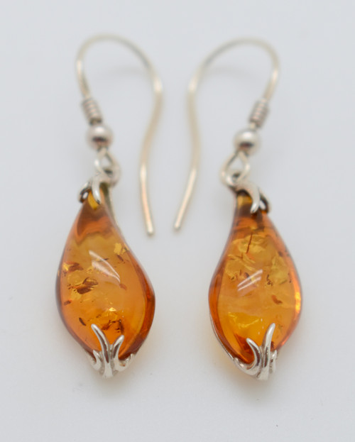 Oval Amber with silver roots