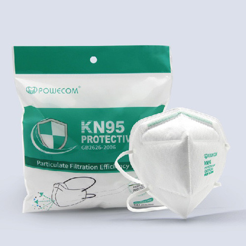 The Powecom FDA authorized KN95 with headband and the packaging right next to it casting a slight shadow.