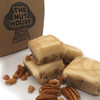 <p>This delicious butterscotch fudge is loaded with pecans, topped with vanilla and cream cheese fudgewith a drizzle of butterscotch on top. If you like butterscotch you have to try this one!</p> <p><strong>Each pound is cut into 4 thick 1/4 pound squares. That's a lotta fudge!!</strong></p> <p><strong><span>PLEASE ACKNOWLEDGE:</span>Some fudge can take 72 hours to ship if not already made. Call for availability. 918-266-1604</strong></p>
