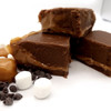 <p>Something like a Milky Way candy bar. Layers of chocolate with light, airy caramel filling.</p> <p><span><strong>Each pound is cut into 4 thick 1/4 pound squares. That's a lotta fudge!!</strong></span></p> <p><span><strong>PLEASE ACKNOWLEDGE: Some fudge can take 72 hours to ship if not already made. Call for availability. 918-266-1604</strong></span></p>