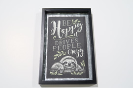 Give yourself a positive reminder with this steel plaque made with a chalk on chalkboard design in a black frame. 2 Assorted Designs: Cactus/RUN WHEN YOU CAN WALK IF YOU HAVE TO CRAWL IF YOU MUST JUST NEVER GIVE UP, Sloth/BE HAPPY IT DRIVES PEOPLE CRAZY. Fir, Galvanized Steel, Paper. 6x0.75x9(in)