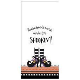 Cute striped witchy boots on a jacquard-trimmed kitchen towel.