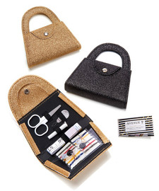 Mini purse holds all the essentials for repairs on the go. Tiny scissors, tape measure, a variety of thread, needles, buttons, and safety pins