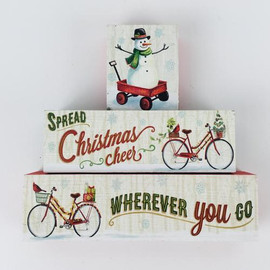 """Set of three wood blocks with vintage travel theme and snowmen, bikes, wagons. 1.04 lbs largest block is 7.25"""" x 2.25"""" x 1"""""""