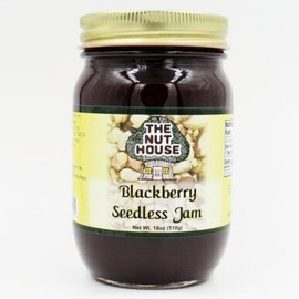 """Our seedless blackberry jam is just as flavorful as the traditional variety.  """"Just Naturally Good."""" It is 100% all-natural with no artificial colors or sweeteners.  Ingredients: Sugar, blackberry puree, water, pectin, citric acid. Produced by equipment handling nuts."""