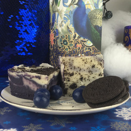 <p>Bottom layer vanilla fudge with blue food coloring and dark chocolate liqueur. Second layer is vanilla fudge, cream cheese flavor, and blue berry mash. Third layer is the same as the bottom. Fourth layer is plain vanilla fudge with cream cheese flavoring. For the sprinkle topping we have smashed up Oreos.</p> <p><strong>Each pound is cut into 4 thick 1/4 pound squares. That's a lotta fudge!!</strong></p> <p><strong><span>PLEASE ACKNOWLEDGE:</span>Some fudge can take 72 hours to ship if not already made. Call for availability. 918-266-1604</strong></p>