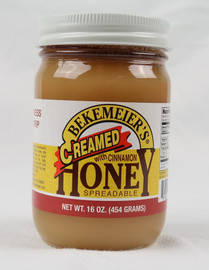Grand Pa's Spun Honey with Cinnamon. Doesn't dribble or drip like regular honey, spreads smooth like butter! Contains Honey and cinnamon. Made in Oklahoma!