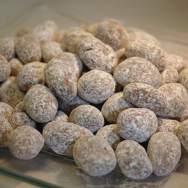 Almonds in buttery toffee and creamy milk chocolate, dusted with confectioners sugar.