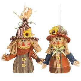 """Boy and girl scarecrow ornament assortment. Boy with straw hat and hair sticking out of the top . Girl with a straw bonnet with a little flower on it. A loop on the back of each item for hanging. Scarecrows: 5 1/2""""H X 3 1/2""""W X 1 3/4""""D.  Sold individually."""