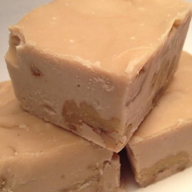 <p>Maple and walnuts swirled together to create a rich decadent fudge.</p> <p>Maple Walnut Fudge is Granny's favorite and a must try for all ages! Gluten Free</p> <p><strong>Each pound is cut into 4 thick 1/4 pound squares. That's a lotta fudge!!</strong></p> <p><strong><span>PLEASE ACKNOWLEDGE:</span>Some fudge can take 72 hours to ship if not already made. Call for availability. 918-266-1604</strong></p>