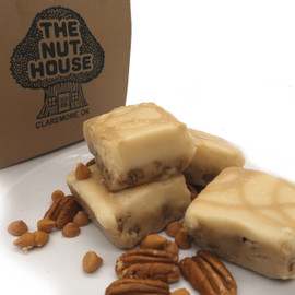 <p>This delicious butterscotch fudge is loaded with pecans, topped with vanilla and cream cheese fudge with a drizzle of butterscotch on top. If you like butterscotch you have to try this one! </p> <p><strong>Each pound is cut into 4 thick 1/4 pound squares. That's a lotta fudge!!</strong></p> <p><strong><span>PLEASE ACKNOWLEDGE:</span> Some fudge can take 72 hours to ship if not already made. Call for availability. 918-266-1604</strong></p>