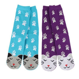 Cat lovers will want to get their paws on these socks! Acrylic knit socks feature pawprint and cat face design. Comes in gift packaging with ribbon accent and window. One size fits most.