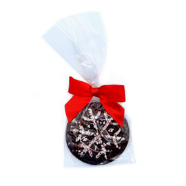 Individually wrapped 1.75 oz Dark Chocolate Peppermint Snowflake has a red ribbon.