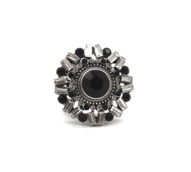 These adjustable Fancy Focal Rings (available in a silver/crystal/black or a gold/crystal/pearl) are full of dazzling detail, color, and clarity! Each stunning piece is a fashion work of art with a bold focal accent surrounded by sparkling glass crystals of varying shapes and colors. Pair it with any outfit to add a touch of glam!
