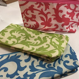 "Zippered fabric pouch is 9"" x 4 1/2 "" and comes in three damask patterns of pink, green or blue.  Each is sold individually."