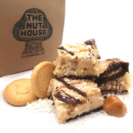 <p>Vanilla fudge with wafer cookie chunks, caramel, coconut, peanut butter and a chocolate bottom layer. Like the Girl Scout cookie!í«ÌÎ_</p> <p><strong>Each pound is cut into 4 thick 1/4 pound squares. That's a lotta fudge!!</strong></p> <p><strong><span>PLEASE ACKNOWLEDGE:</span>Some fudge can take 72 hours to ship if not already made. Call for availability. 918-266-1604</strong></p>