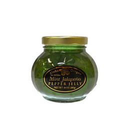 "Aloha From Oregon's Mint Jalapeño Pepper Jelly is an ""All Natural"" treat with bits of mint and green jalapeño peppers. This delicious jelly will be a sensation with lamb or chicken; drizzled on veggies and is often used in Greek recipes."