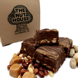 <p>Our famous chocolate fudge with a thick layer of caramel and peanuts in the middle. A Top Seller!</p> <p><span><strong>Each pound is cut into 4 thick 1/4 pound squares. That's a lotta fudge!!</strong></span></p> <p><span><strong>PLEASE ACKNOWLEDGE: Some fudge can take 72 hours to ship if not already made. Call for availability. 918-266-1604</strong></span></p>