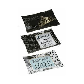 "These black and white glass trays feature gold accents and various sassy sentiments.  Three assorted designs.  Sold individually.  Dimensions: 4"" W. x 6"" L."