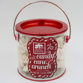 Creamy White candy cane crunch in a festive container with a red foil lid. Popcorn mixed with white chocolate and peppermint crunchies.