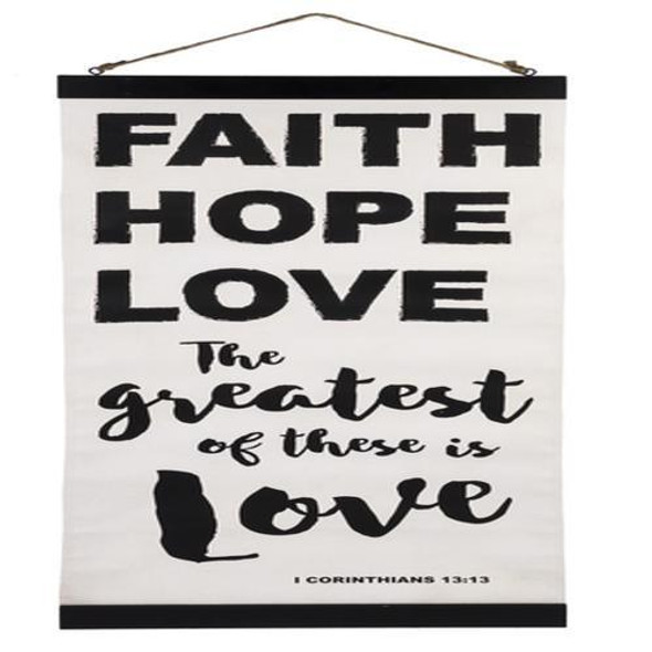 "Vertical banner with black script printed on white canvas featuring quote from 1 Corinthians 13:13  ""Faith Hope Love The Greatest of these is Love"" with a jute cord for hanging. Canvas rolls to store. Unrolled size 14"" wide 31"" long"