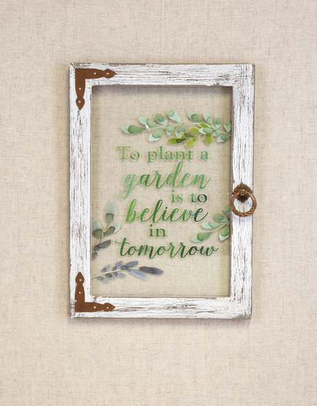 """Glass window with wooden frame measures 81/2"""" W. x 1/2"""" D. x 12"""" H  Printed in green: """"To plant a garden is to believe in tomorrow"""""""