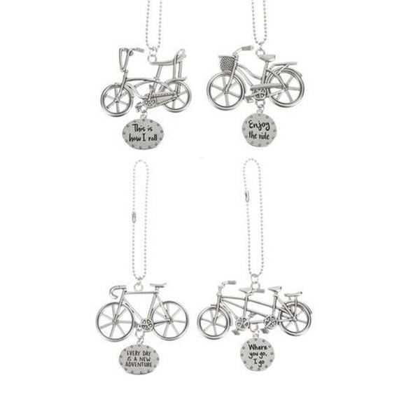 """Four assorted designs with various sentiments: """"This is How I Roll."""" """"Enjoy the Ride."""" """"Every Day is a New Adventure."""" and """"Where You Go, I Go.""""  Each is sold individually."""