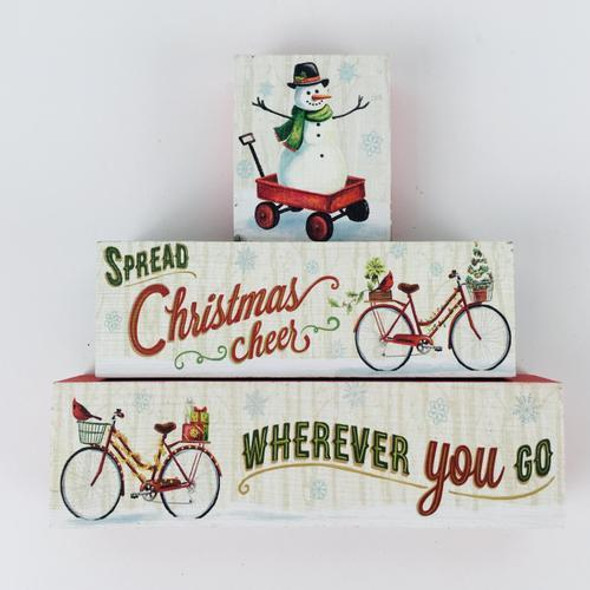 "Set of three wood blocks with vintage travel theme and snowmen, bikes, wagons. 1.04 lbs largest block is 7.25"" x 2.25"" x 1"""
