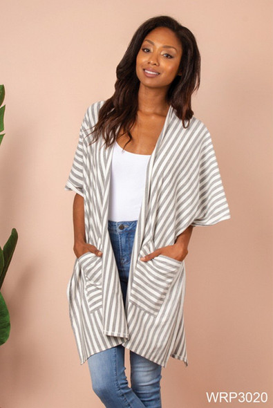 Elegant and summery fashion- easy to dress up a pair of jeans or as a stylish swimsuit coverup, this Simply Noelle Waterline striped wrap is made of 92% poly 5% viscose 3% elastase. One size fits most.