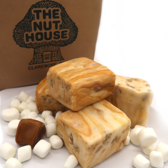 Our Caramel Divinity Fudge is a fluffy nougat-like confection fudge made with marshmallow creme, egg white, corn syrup, sugar and filled with pecans and topped with delicious caramel. Gluten Free and we ship Nationwide!