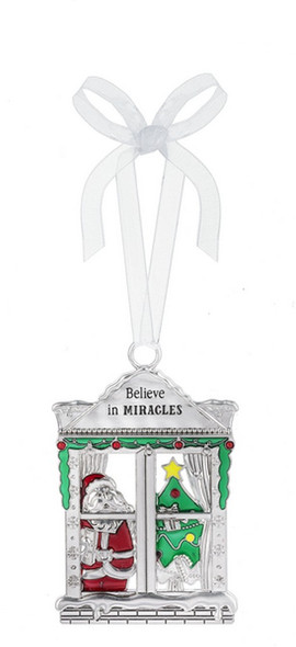 """Silver window ornament featuring Santa and Christmas Tree Dimensions: 2"""" W. x 2 7/8"""" H"""