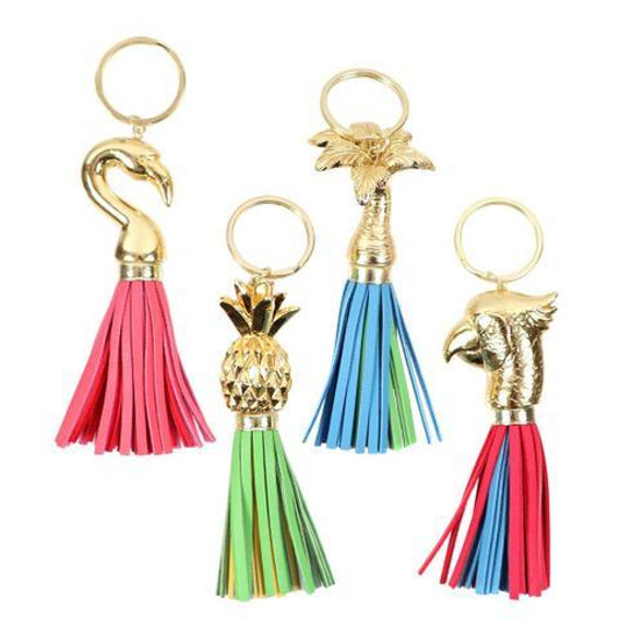 Tropical Tassel Keychain A cute gift for anyone who loves the beach or anything tropical! Polyresin keychain features bright colored tassel with gold tropical icons. 4 assorted styles.  Measures: 4 1/2""