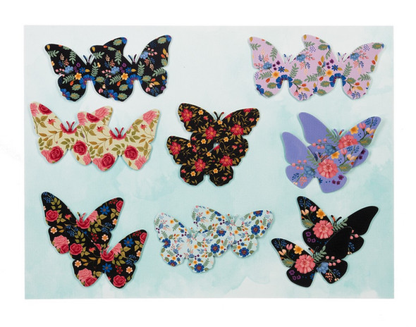 """A variety of floral and chintz designs on assorted metal butterfly magnets add spring whimsy to your fridge or memo board. About 3"""" wide."""