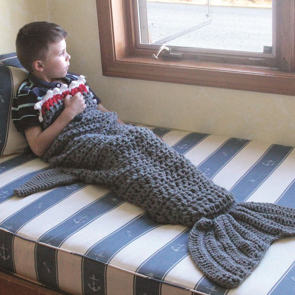 This whimsical shark tail blanket is the coolest way to keep warm! Acrylic blanket features hand knit shark design. One size fits most kids and adults. Handwash only. Material: Acrylic Size: 56""