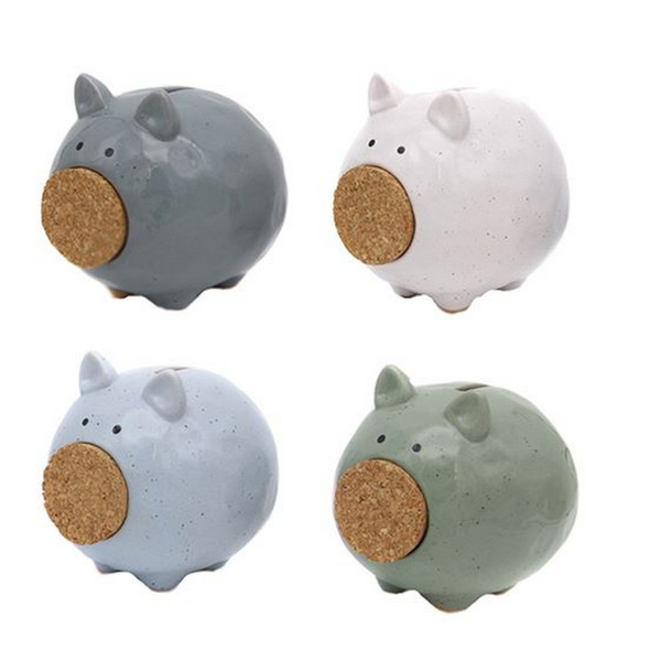 """This adorable farmhouse styled piggy bank will help you save your spare change! Ceramic piggy bank features speckled glaze finish and cork nose. 5"""" x 5"""""""