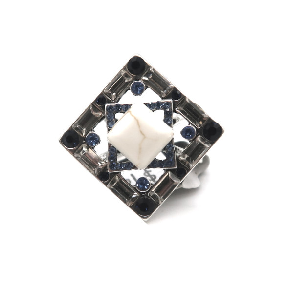 White, blue, and black rhinestones around a square marble center on this pretty silver ring.