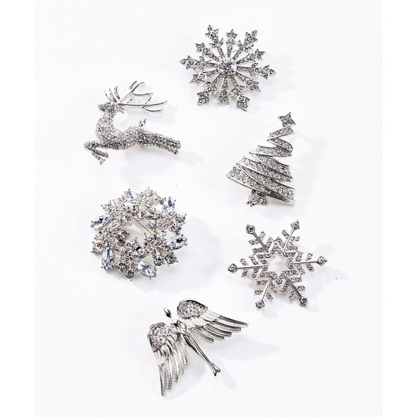 Dress up a top, hat or scarf with this shimmering silver brooch designed with glitter and rhinetones. Choose from six designs, wreath, tree, reindeer, angel, snowflake with open center, snowflake with jewel center. Gift boxed. Sold individually.