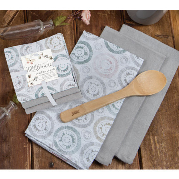 Three piece hand-stamped set of linen flour sack towels. Design is muted shades of stone, coral and blue. Comes with two coordinating stone-colored towels. A gentle palette for any style decor from modern to farmhouse.