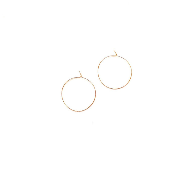 Simple gold hoop earrings are so light weight and perfect for everyday wear.  Made in United States of America