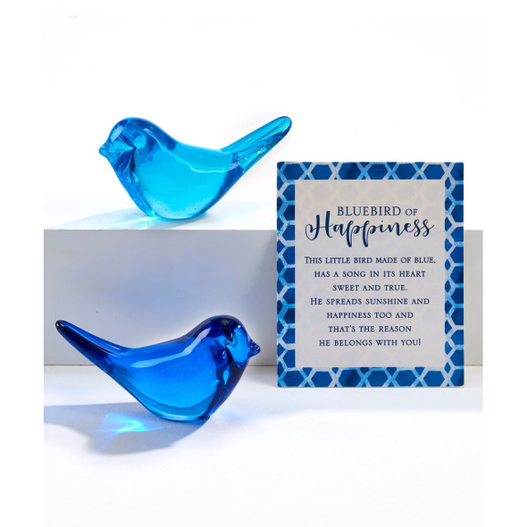 """Glass bluebird is pretty perched on a windowsill to catch the light, but is smooth enough to carry comfortably in a pocket. Measures about 1.5"""". Comes with sentiment card."""