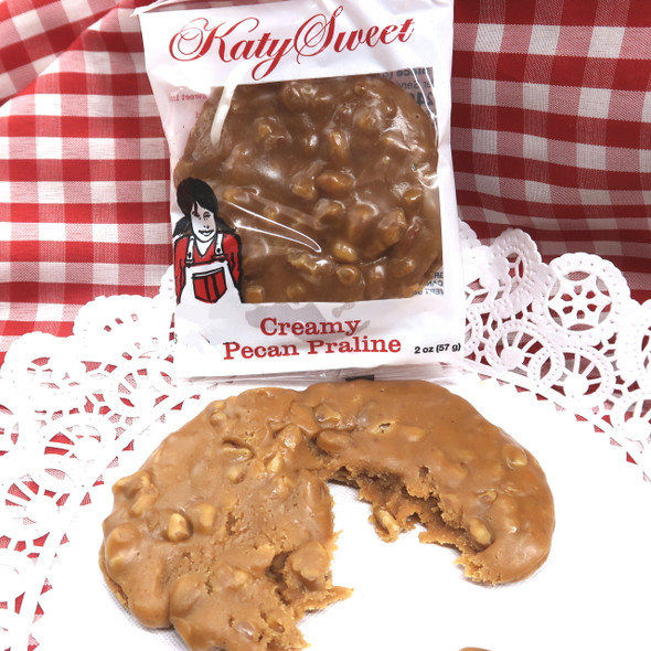 Here is the quintessential praline- creamy and classic with caramel and fresh pecans, each of these are hand-made in Texas from a tradional family recipe. These taste even better than they look and are beloved by customers and employees alike! Kosher, gluten free 2 oz patties individually wrapped.