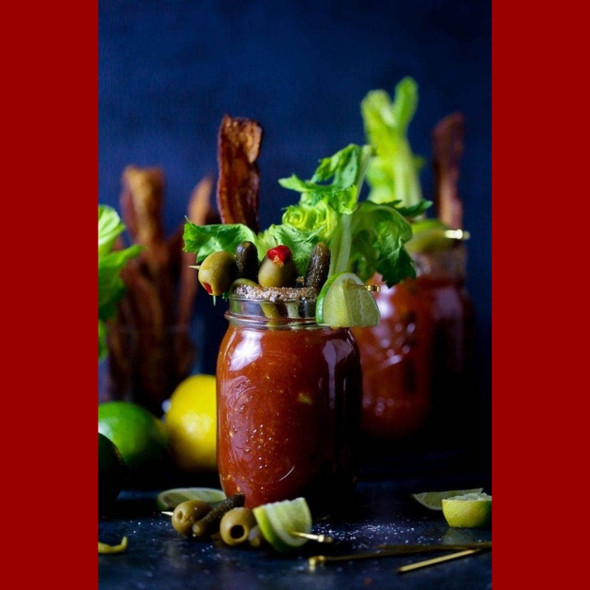 """You don't even need to stand in a bathroom whispering """"Bloody Mary"""" into the mirror to appreciate the heat in this deliciously zesty drink mixer bursting with tomatoes, habaneros with added ghost peppers for extra hotness... just add vodka!"""